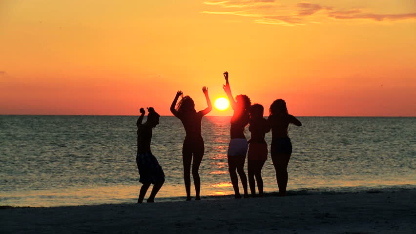 Young People in Silhouette Enjoying Stock Footage Video