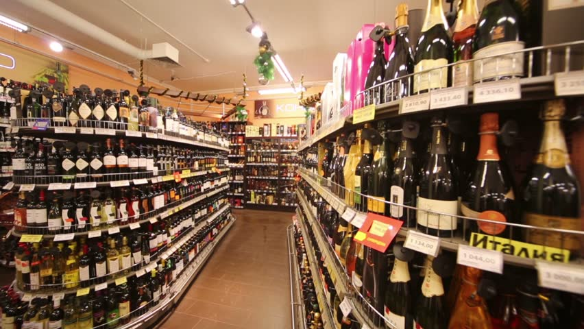 MOSCOW, RUSSIA - DEC 8, 2012: Section of alcohol in supermarket of home food Bahetle. Currently company Bahetle has 25 stores.