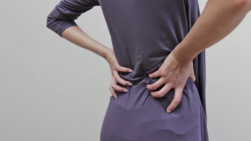 woman with backpain, spinal, waist, lower back problem, quarter view from rear closeup shot