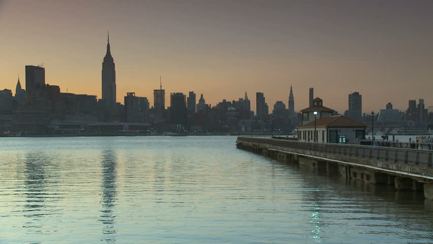New York City skyline over looking a pier in Hoboken at dawn. | Shutterstock HD Video #601828