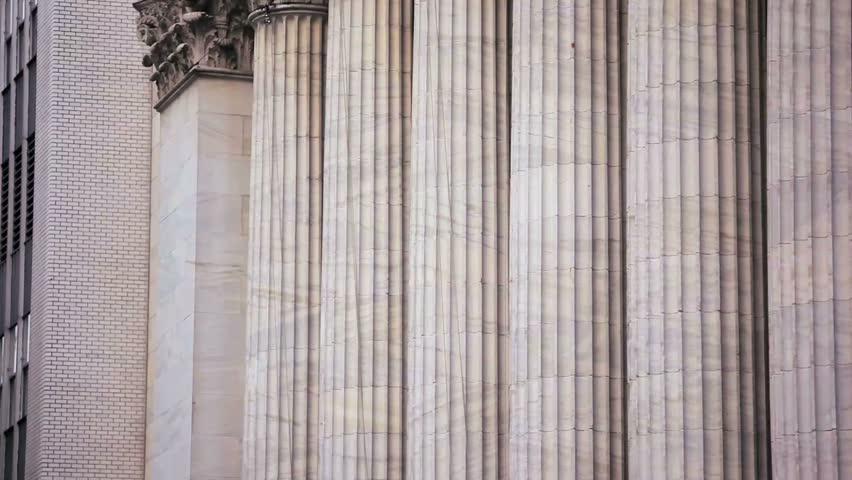 Tilt up shot of the New York Stock Exchange building.   Shutterstock HD Video #6057347