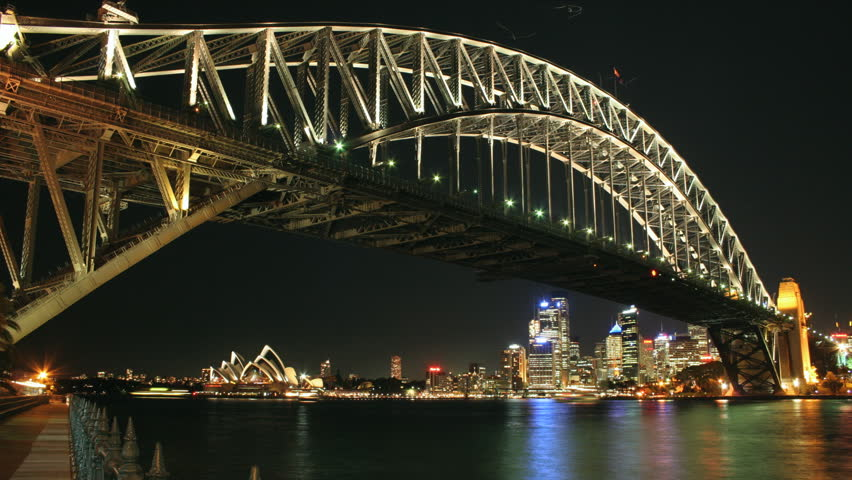 Time lapse of Sydney Harbour #5. A night from the far side of the harbour  featuring Sydney Harbour Bridge in the foreground and the Sydney Opera House in background.