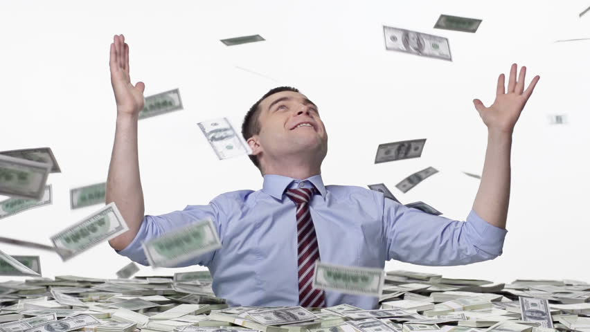 Man welded by money, trying to catch the falling notes | Shutterstock HD Video #6071120