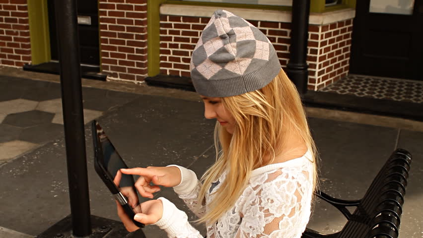 Young hip woman using her tablet on city bench | Shutterstock HD Video #6074597