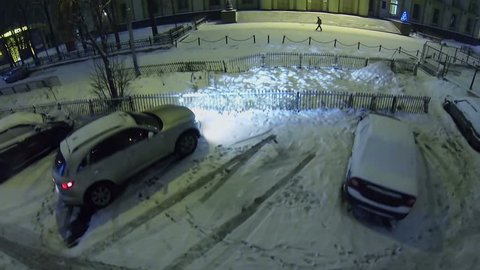 Cars parked near edifice of headend system design bureau of concern Almaz-Antey at winter snowy night in Moscow. Aerial view. Company is leader in development of anti-aircraft guided missile weapons.