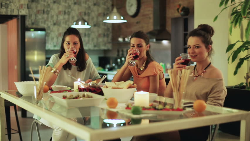 Women partying in house cheers drinking wine and smiling.  | Shutterstock HD Video #6081164