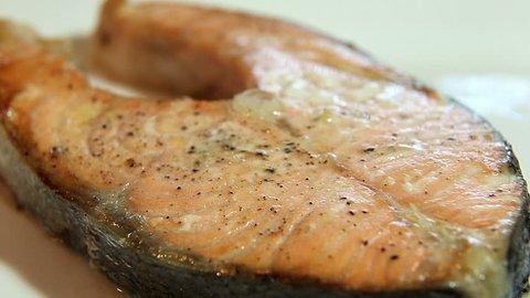 Slicing a juicy salmon steak.