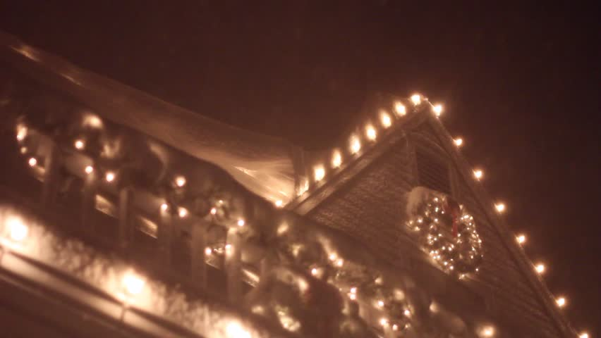 Christmas lights on a roof in a heavy storm | Shutterstock HD Video #6084917
