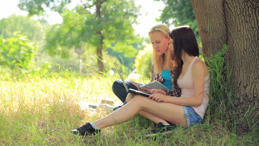 Lesbians Relaxing Outdoors Stock Photo By Annastills