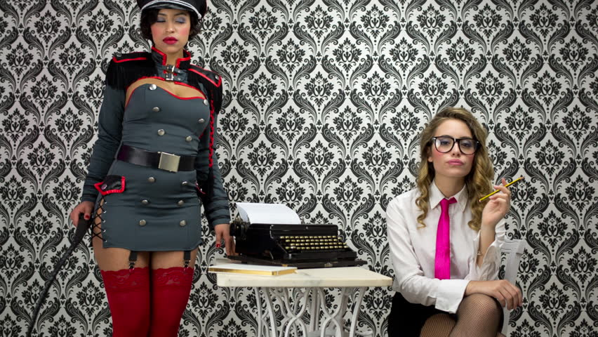 beautiful military boss and her sexy secretary. Office, business and fashion, lifestyle uses