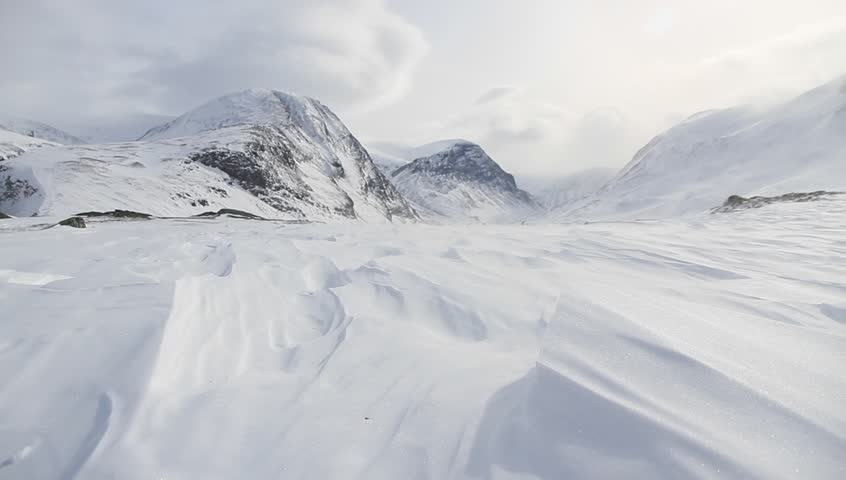 Wind blowing over the snow (spin drift) in the mountains of Lapland, Sweden. | Shutterstock HD Video #6111062