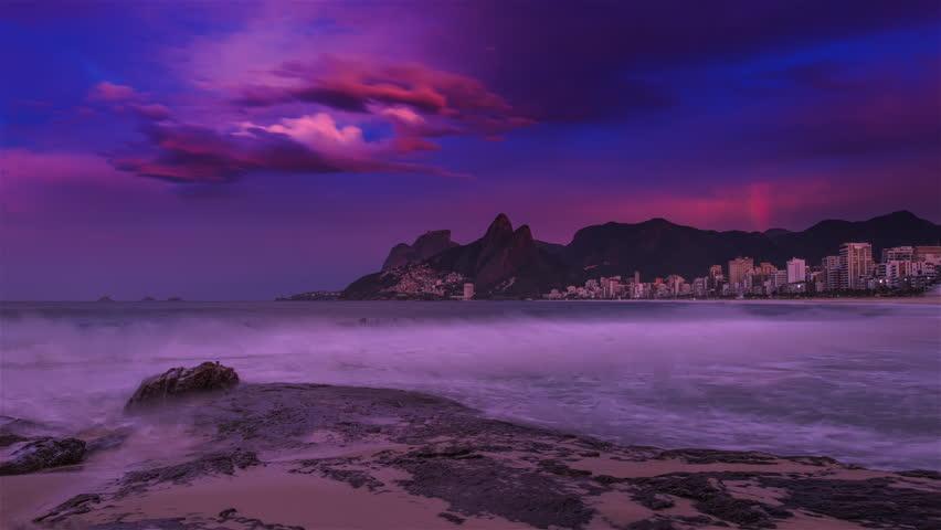 Sliding time-lapse of the beach, and Rio de Janeiro with a rainbow. #6112802