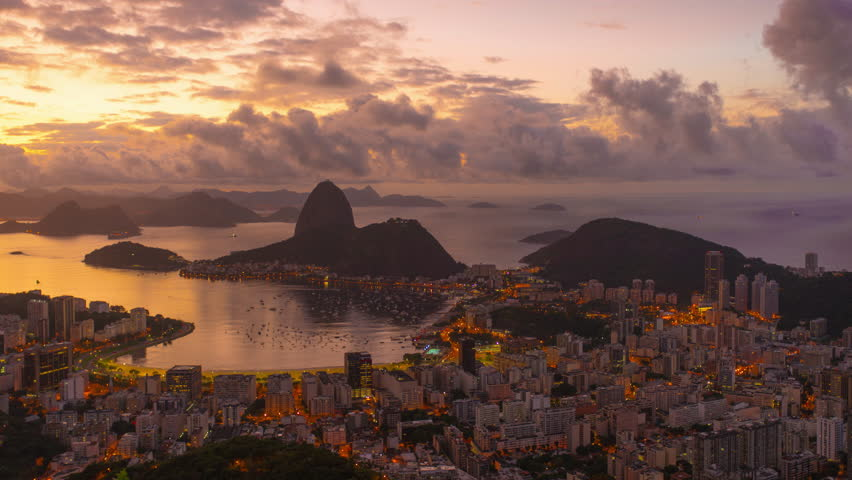 Sunrise time-lapse overlooking Rio de Janeiro and Sugarloaf Mountain. | Shutterstock HD Video #6112826