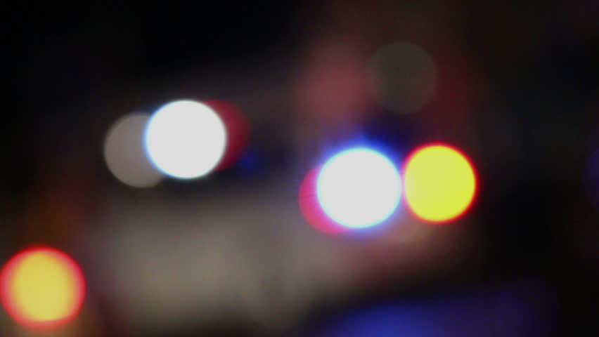 Out-of-focus flashing police car lights.