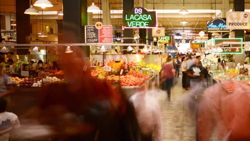 LOS ANGELES, California - April 9th: 4K Time lapse Photography with pan motion of unrecognizable shoppers gather at historic Grand Central Market in Downtown Los Angeles on April 9th.