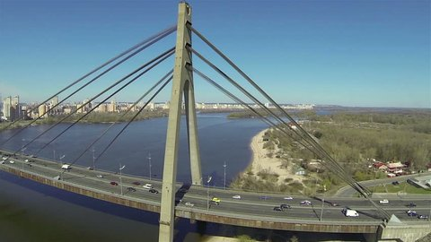 bridge with cars over  river in  city. Aerial