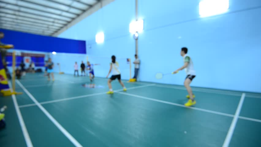 Badminton courts with players competing in indoor