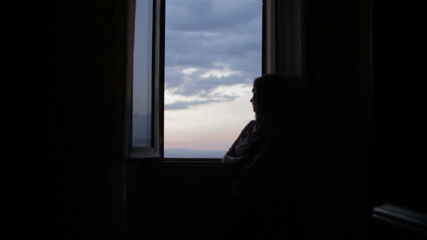 Sad and lonely woman looks out the window | Shutterstock HD Video #6165926
