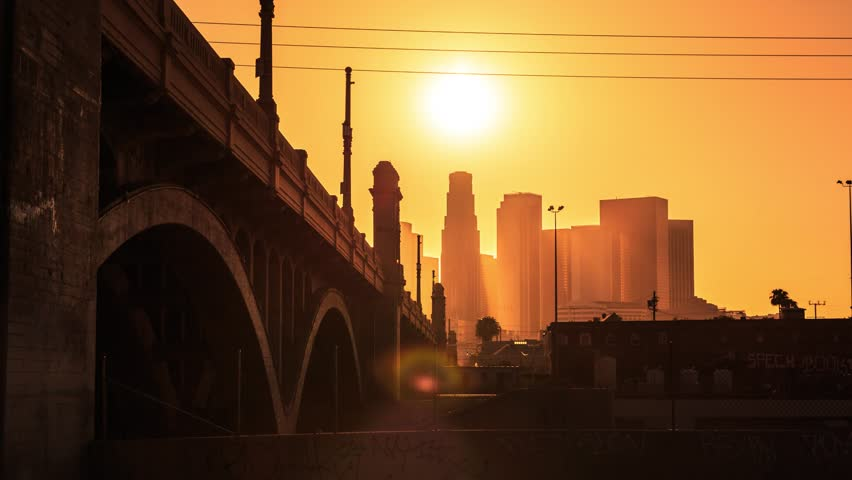 4K. Los Angeles city. Sunset sun setting into downtown LA skyline. Timelapse in motion (hyperlapse).