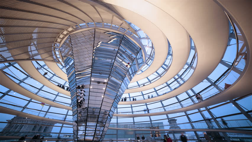 BERLIN - APRIL 2014: Tourists walk down the spiral walkway of the Reichstag building dome. The Reichstag dome is renowned for its progressive modern architecture.