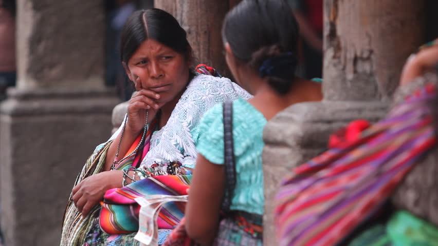 ANTIGUA GUATEMALA,GUATEMALA, MARCH 2012:Guatemalan women.Guatemalan woman sitting next to the the labor exchange