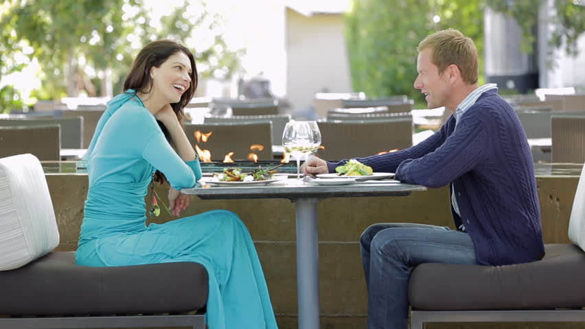 Couple enjoying a gourmet dinner outdoors at a luxury resort   Shutterstock HD Video #6216311