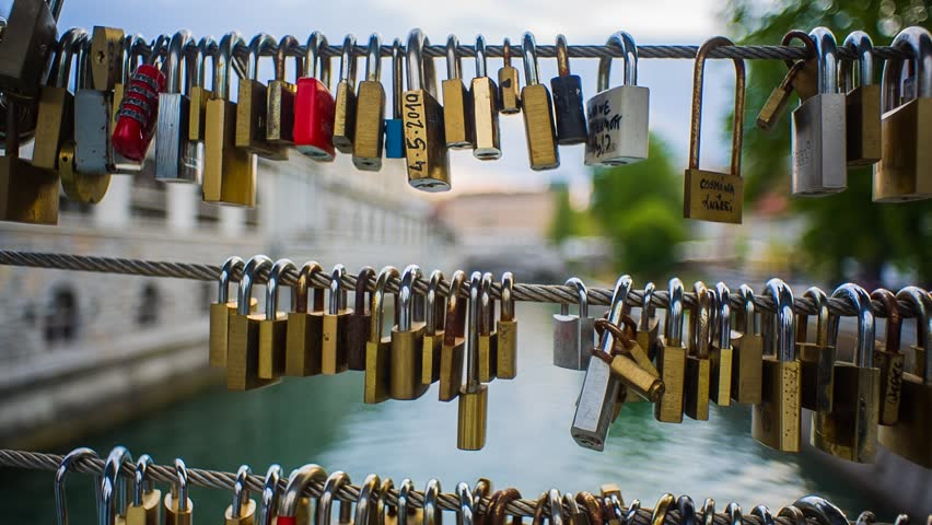 Ljubljana, Slovenia - April 2014: Love Locks of All sort Hanging on Bridge Fence | Shutterstock HD Video #6219860