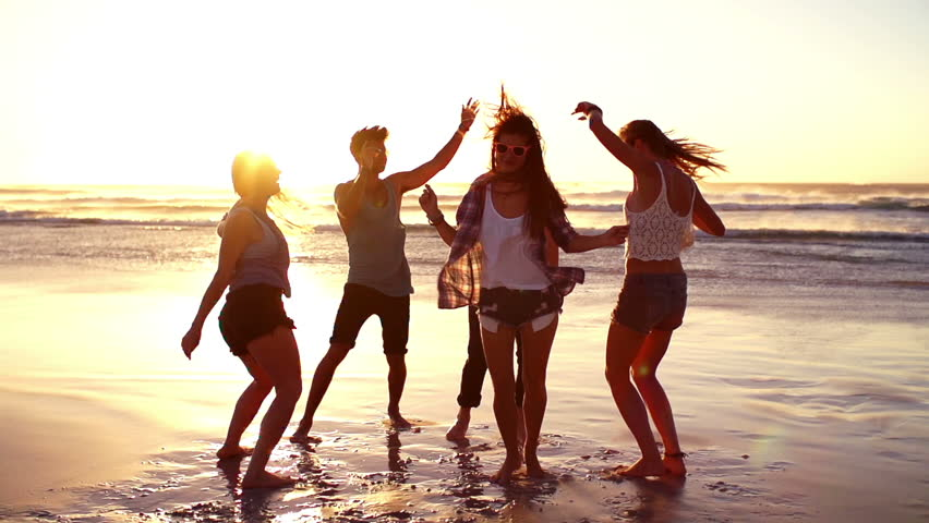 Friends dancing on beach in sunset #6222647