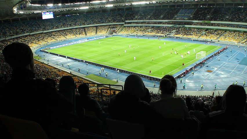 Failed attack football match, fans boo disappointed, stadium. People watching soccer competition at sports arena. Players running, kicking ball on illuminated field. Emotions of unhappy spectators  | Shutterstock HD Video #6228086