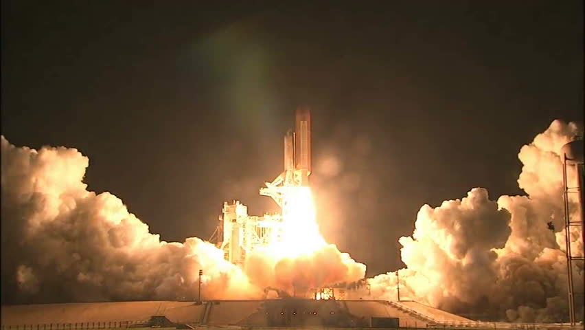 CIRCA 2010s - The Space Shuttle Discover launches at night. Royalty-Free Stock Footage #6228701