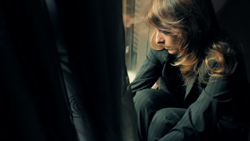 Sad businesswoman sitting on the floor near window | Shutterstock HD Video #6229451