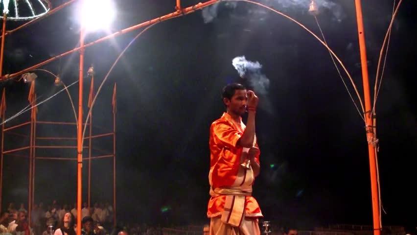 VARANASI, INDIA - NOVEMBER 17: Unidentified Hindu priest performing the religious Ganga Aarti ritual (fire puja) at Dashashwamedh Ghat on November 17, 2011 in Varanasi, Uttar Pradesh, Central India #6238919