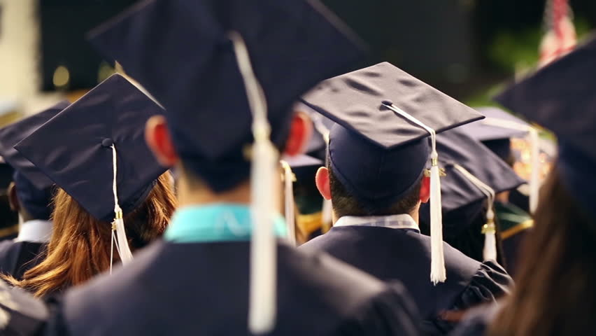 Students graduating from university campus - celebration.