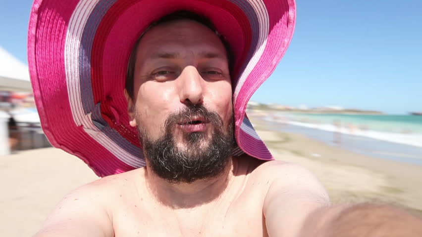Young adult man spinning around on beach having fun taking video selfie. Closeup, hand held, outdoor sunny daylight shot. | Shutterstock HD Video #6248432