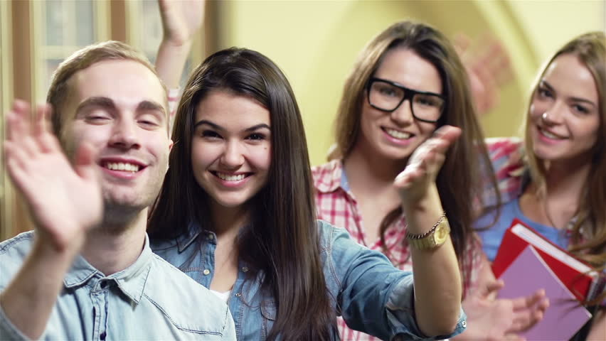 Group of teenagers cheerfully waving with the hand to the camera Royalty-Free Stock Footage #6249065