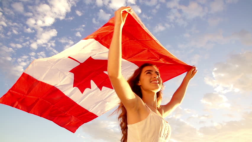 Woman Holding Canadian Flag Against Stock Footage Video (100% Royalty-free)  6252614 | Shutterstock
