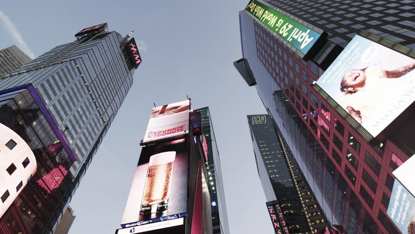 NEW YORK - APRIL 17, 2014: upward angle driving on Broadway Times Square tall signs lights marquees moving night New York. Times Square is an intersection and neighborhood in Manhattan, NYC, USA 4K