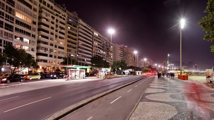 RIO DE JANEIRO, BRAZIL – CIRCA 2014: Avenida Atlantica (Portuguese for Atlantic Avenue) at night is a major seaside avenue,  spans the entire length of the neighborhoods of Copacabana and Leme. | Shutterstock HD Video #6276143