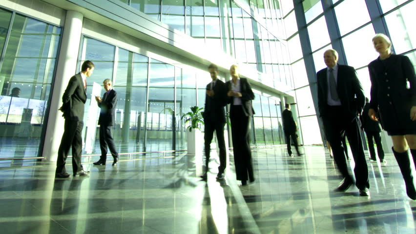 Time lapse of diverse business group in a large modern corporate building | Shutterstock HD Video #6283145
