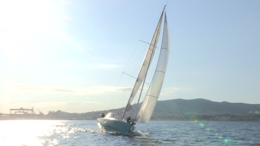 Sailing boat navigating in the sea with open sails  #6285374