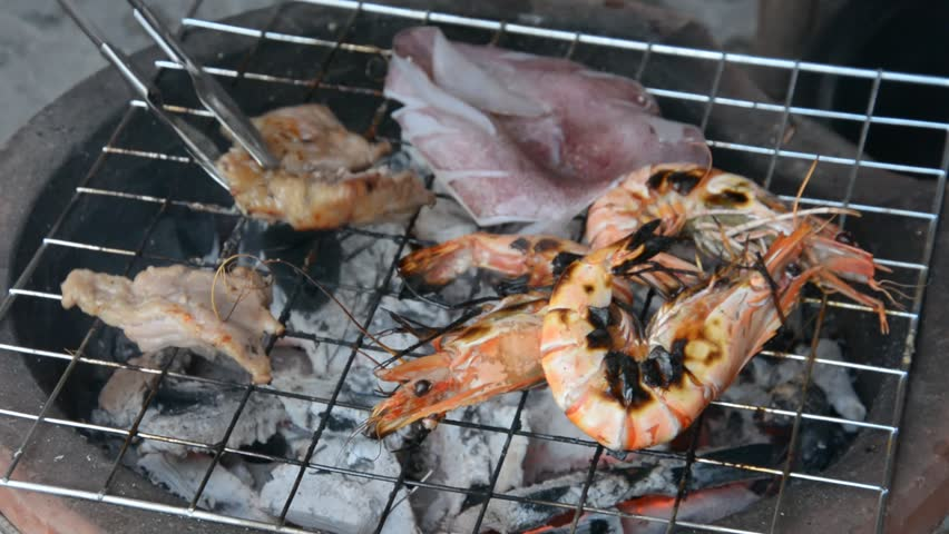 Grilled shrimps ,pork,squid , with flames in background    Shutterstock HD Video #6308861