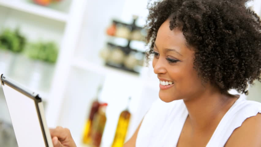 Pretty Ethnic Female Kitchen Social Messaging Wireless Tablet - Young African American female sitting home kitchen counter reading social messaging wireless tablet | Shutterstock HD Video #6329927