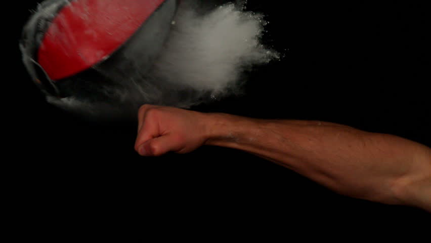 Hand punching maize bag on black background in slow motion | Shutterstock HD Video #6335186