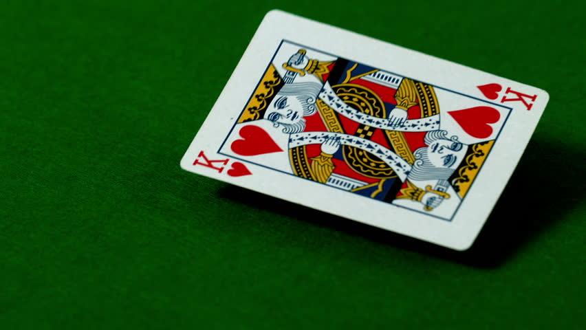 King of hearts falling on casino table in slow motion | Shutterstock HD Video #6335690