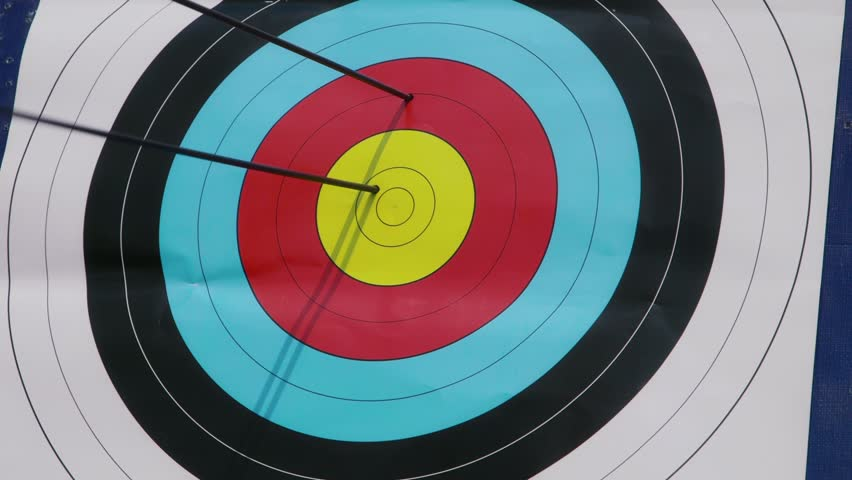 People shooting arrows, bow, archery, people, sport, target, bull's-eye, bullseye. Symbol of victory, achievement, success. 5of26