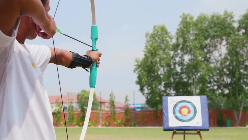 Young man training at archery with bow and arrows, people, sports, fun and leisure, recreation. 3of26