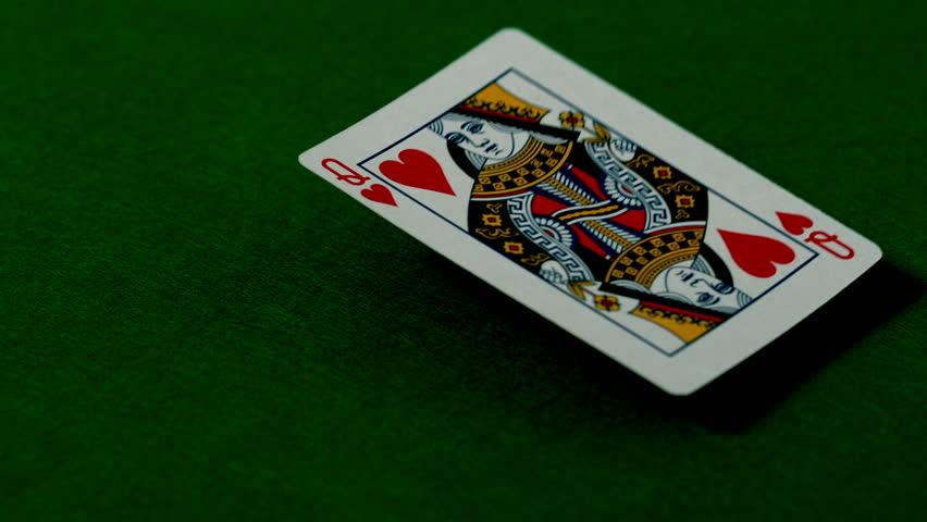 Queen of hearts falling on casino table in slow motion | Shutterstock HD Video #6337439