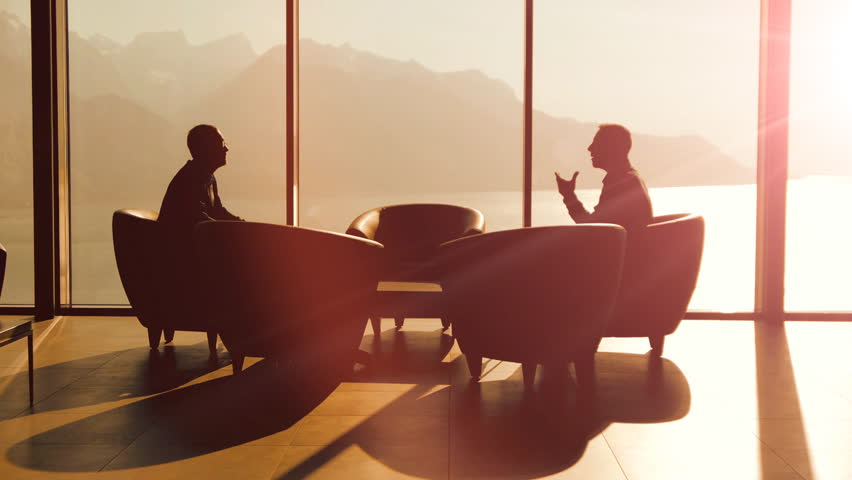 Business discussion talking. silhouette. business background. handshake. company career corporate. cooperation. professionals. luxury interior. business meeting. 2 businessman having a conversation