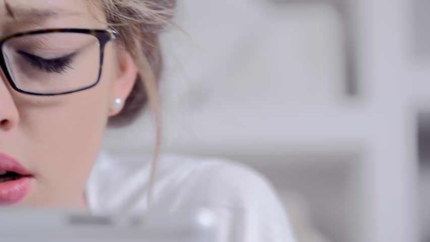 Attractive young blonde woman using tablet computer touchscreen. | Shutterstock HD Video #6355973