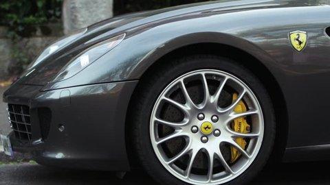 MARANELLO, ITALY - APRIL 24, 2014: Ferrari sport car as seen on the streets of Maranello on Apr 24. Panning left to right. Ferrari S.p.A. an Italian luxury sports car manufacturer based in Maranello